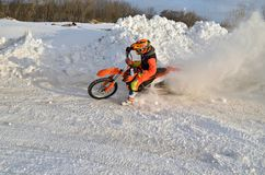 MX winter, turn with emphasis in a snowdrift racer Stock Images