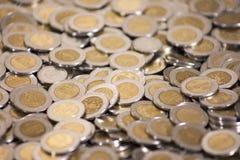 Mxn de achtergrond van pesomuntstukken Stock Foto's