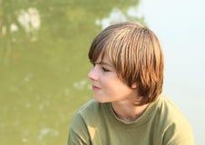 Myśląca chłopiec Fotografia Stock