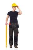 Myślący ręczny pracownik z pomiarowym instrumentem Zdjęcie Royalty Free