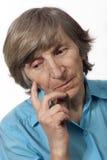 myśli starsza kobieta zdjęcia stock