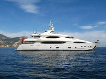 MY. Modern white Motor yacht at anchor on a flat sea Royalty Free Stock Images