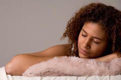 My african dream. Cute African girl is falling a sleep in her bed Royalty Free Stock Image