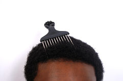 My Afro. This is an image of a black man with a comb stuck in his afro Royalty Free Stock Image