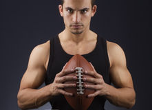 This is my ball. Young athlete holding a football ball Royalty Free Stock Images