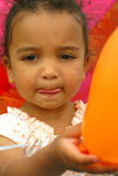 My Balloon. A beautiful mixed race girl holding a balloon Royalty Free Stock Images
