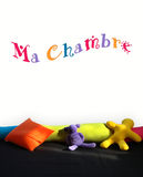 My bedroom written in French on a wall of a child room. With colorful cushions Stock Images