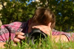 My beloved one taking photos on the ground Royalty Free Stock Photography