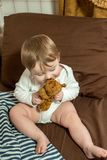 My Best Friend baby sleeping with her teddy bear, New family and baby protection concept royalty free stock photos