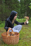 My biggest one. Happy teenager looking for biggest mushroom Royalty Free Stock Photography