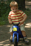 On my bike. Young boy playing with his motorbike Royalty Free Stock Image