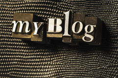 My Blog. The words My Blog photographed using vintage type charcters on a textured background Royalty Free Stock Photo
