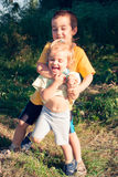 My brother's wave of sympathy. Brother and sister playing in garden Royalty Free Stock Photography