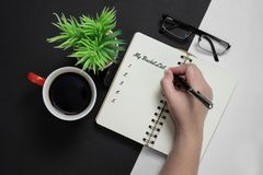 My Bucket List. Hand writing on notebook with coffee mug, potted plant and spectacle Royalty Free Stock Photo
