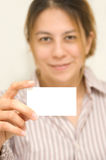 My business card. Young woman holding up an blank business card Stock Images