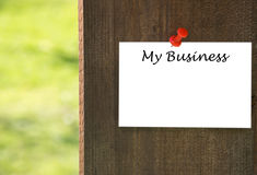 My business inscription on white note paper with a wooden background Stock Photos