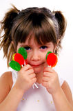 My candy. A young girl with a handful of suckers royalty free stock images