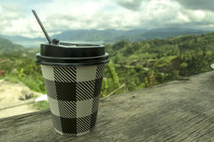 My coffee2. Cup of coffee with the background scenery, which can be edited for presentation Stock Photography