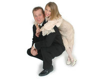 My Cool Dad. Young girl leaning on her fathers shoulder as he kneels down on the floor. This is an image from a father taking his daughter to the annual father royalty free stock photo