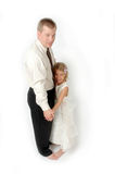 My Dad and I. Little girl stands on her dads toes and learns to dance stock photography