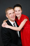 My Daddy. A father with his older daughter on black background wearing a suit Royalty Free Stock Image
