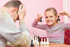 My daughter is happy that Pope played two pawns and win in chess Stock Image