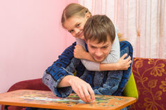 My daughter hugged Dad is collects mosaic Royalty Free Stock Image