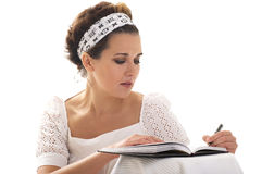 My dear dairy. Girl writing a note in her diary Stock Photography