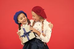 For my dear friend. Girl giving gift box to friend. Girls friends celebrate holiday. Children formal wear with gift box stock photography