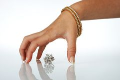 My diamonds. Elegant female hand reflected over a diamond ring Stock Images