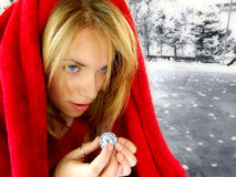 My disco ball world. A young adult woman in a red cloak holding a tiny disco ball stock photos