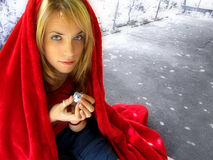 My disco ball world. An attractive young woman in a red cloak holding a tiny disco ball stock photography
