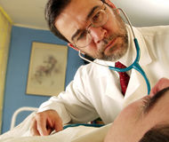 My doctor. Doctor with a patient using an stethoscope Stock Photography