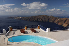 Home swimming water pool. On the terrace. Santorini,Greece royalty free stock image