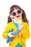 My dream is to become singer. Portrait a little pretty girl dressing up as famous singer Royalty Free Stock Image