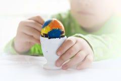 My egg. Girl painting her Easter Egg Stock Photography