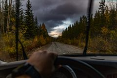 My escape into something new. A POV perspective of driving along a dirt road in the wake of a passing storm Stock Images