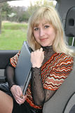 My Fair Lady. Lady with the laptop in the car Royalty Free Stock Image