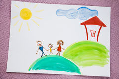 My family. Children's drawing paints on which are drawn a family, the house, the sun Royalty Free Stock Photos