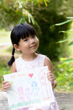 My family. Little child shows drawing of her family member Royalty Free Stock Photo
