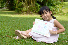 My family. Little child shows drawing of her family member Stock Images