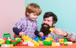My family is my inspiration. happy family leisure. love. child development. building with constructor. father and son royalty free stock images