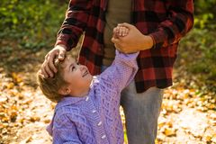 My father is my world. Parental support. Help kid explore world. Dad hold hand of little boy. Manly father upbringing stock photos