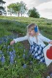 My Favorite Flower. Little girl in a bluebonnet flower field in Texas royalty free stock image