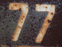 My favorite number. This is the number of my mother`s house. It`s written on an iron plate which rusted because of the rain stock images