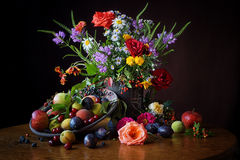 My favorite September. Rich still life, colorful with many flowers and fruits, beautiful handmade pottery with sgraffito technique royalty free stock image