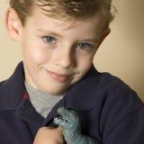 My favourite toy. Boy holding toy dinosaur Stock Photography