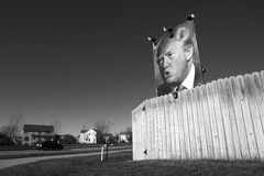 My Fence is Going to be Huge. Des Moines, Iowa, United States – December 10, 2015: An ardent supporter of Donald Trump put up his own billboard at his home in Royalty Free Stock Photography