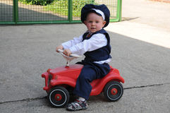 My first car. Little boy with his first car Royalty Free Stock Photos