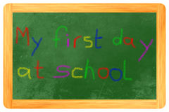 My first day at school colored chalk on blackboard. My 1st day at school with colored chalk on a black board Royalty Free Stock Images